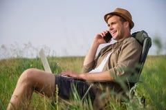 Joyful male tourist using modern technology Royalty Free Stock Photo