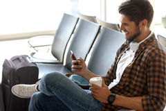 Joyful male tourist waiting for flight Stock Images