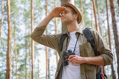 Joyful male traveler searching for place of destination Royalty Free Stock Images