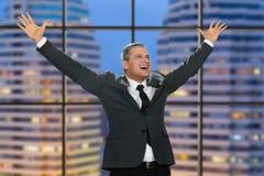 Joyful man with arms raised. Stock Photo