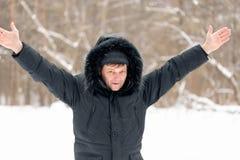 Joyful man in a black winter jacket Stock Image