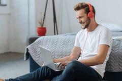 Joyful man feeling happiness while looking at computer Royalty Free Stock Photo