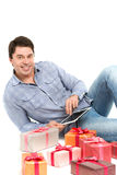 Joyful man and gifts. Stock Photo