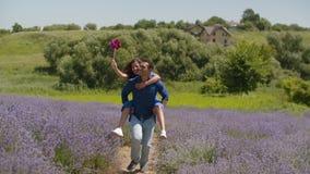 Joyful man giving piggyback ride to woman outdoor