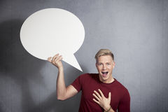 Joyful man holding empty speech bubble. Royalty Free Stock Images