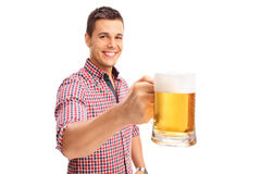Joyful man holding a large beer mug Stock Image