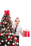 Joyful man holding three Christmas presents Royalty Free Stock Image