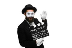 Joyful man in the image mime with movie board Stock Images