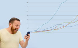 Joyful Man looking into the phone growth chart in the background, successful business, modern businessman Stock Images