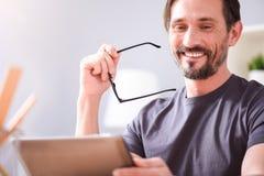 Joyful man and looking at tablet Stock Photo