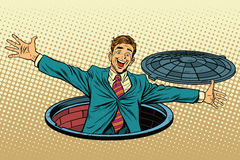 Joyful man in the manhole Stock Photography