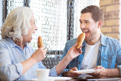 Joyful man resting in the cafe with his grandmother Stock Photography