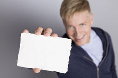 Joyful man showing empty white card. Stock Photography
