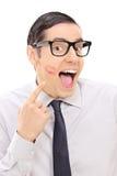 Joyful man showing lipstick kiss mark on his cheek. Isolated on white background Stock Photos