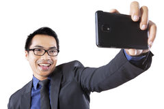 Joyful man taking self portrait Stock Photography