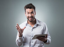 Joyful man using his tablet Stock Photography