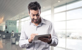 Joyful man using his tablet Stock Image