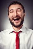 Joyful man över mörkerbakgrund Royaltyfri Foto
