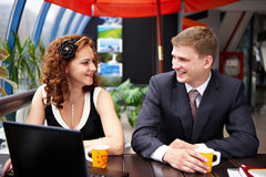 Joyful man and woman on business lunch. In cafe Royalty Free Stock Photo