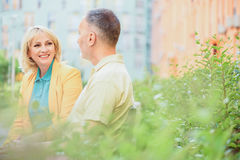 Joyful man and woman dating in park Royalty Free Stock Photography