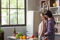 Joyful man and woman having fun at home Stock Photos