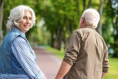 Joyful married couple enjoying walk in park Royalty Free Stock Photos