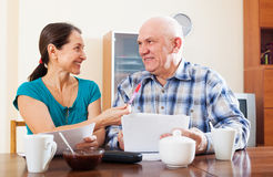 Joyful mature couple with documents Stock Image