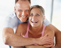 Joyful mature couple enjoying themselves Royalty Free Stock Photos