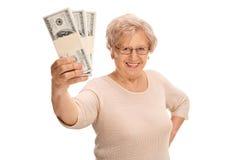 Joyful mature lady holding money Royalty Free Stock Image