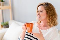 Joyful mature lady relaxing at home Stock Image