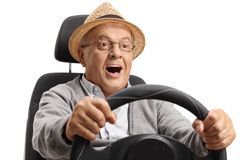 Joyful mature man driving. Isolated on white background royalty free stock image