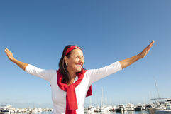 Joyful mature woman marina holiday Royalty Free Stock Photography