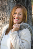 Joyful Mature woman winter jackte outdoor Royalty Free Stock Images