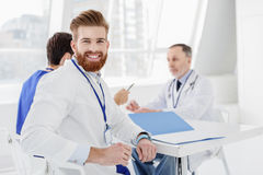 Joyful medical team discussing human health Royalty Free Stock Image