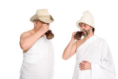 Joyful men drink kvas - russian bread juice Royalty Free Stock Images