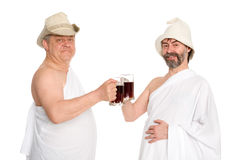 Joyful men drink kvas - russian bread juice Royalty Free Stock Image