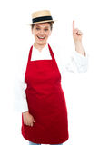 Joyful middle aged cook pointing upwards Royalty Free Stock Photos
