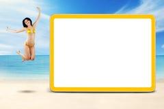 Joyful model with bikini leaps at coast Royalty Free Stock Photos