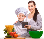 Joyful mom and som are cooking in the kitchen Royalty Free Stock Images