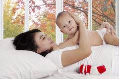 Joyful mother with baby at home Royalty Free Stock Images