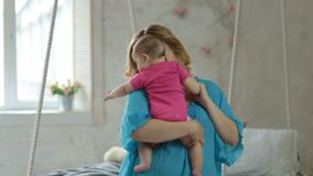Joyful mother dancing with her baby daughter stock video footage