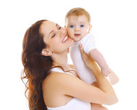 Joyful mother hugging cute baby Royalty Free Stock Photo