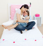 Joyful mother hugging her girl Royalty Free Stock Images