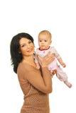 Joyful mother playing with her baby girl Stock Image