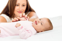 Joyful mother playing with her baby girl Royalty Free Stock Photography