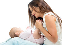 Joyful mother playing with her baby infant Royalty Free Stock Images