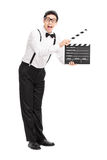 Joyful movie director holding a clapperboard Royalty Free Stock Images