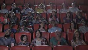 Multinational viewers enjoying comedy in cinema
