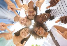 Joyful Multicultural Teenagers Standing In Circle, Showing Funny Gestures, Low Angle