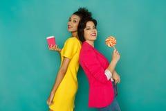 Joyful multiethnic women at azur studio background Royalty Free Stock Photos